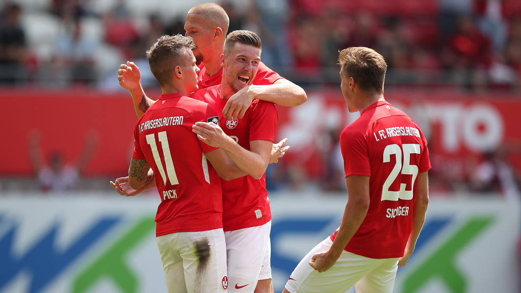 KAISERSLAUTERN, GERMANY - JULY 20: Florian Pick of 1.FC Kaiserslautern celebrates after scoring his team`s first goal with team mates Christian Kuehlwetter of 1.FC Kaiserslautern and Carlo Sickinger of 1.FC Kaiserslautern during the 3. Liga match between 1. FC Kaiserslautern and SpVgg Unterhaching at Fritz-Walter-Stadion on July 20, 2019 in Kaiserslautern, Germany. (Photo by Christian Kaspar-Bartke/Getty Images for DFB)