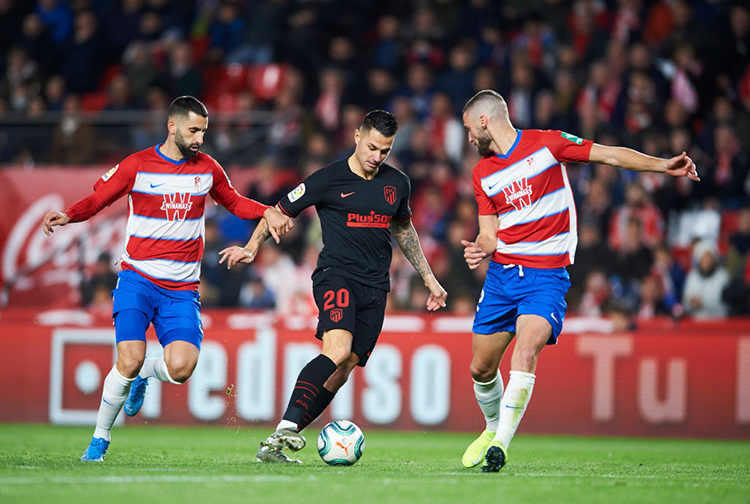 GRANADA, SPAIN - NOVEMBER 23: Victor Machin Perez 'Vitolo' of Club Atletico de Madrid duels for the ball with Domingos Duarte of Granada CF during the Liga match between Granada CF and Club Atletico de Madrid at Estadio Nuevo Los Carmenes on November 23, 2019 in Granada, Spain. (Photo by Aitor Alcalde/Getty Images)